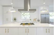 white and gold kitchen with brushed brass pulls