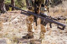 snipe bid soldier with big sniper rifle in forest stock photo