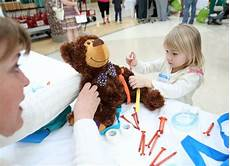 Children Play Doctor Kids Play Doctor At Hospital S Teddy Bear Clinic Spread A