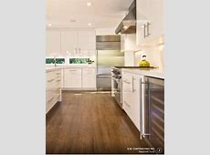 Walnut wood kitchen floor with white or ivory gloss doors, sleek handles, inset sink in white