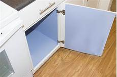 how to cover kitchen cabinets with vinyl paper hunker