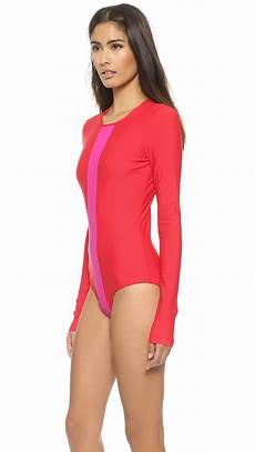 sleeve swimsuit cover sleeve swimsuit fuchsia in lyst