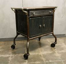 industrial metal cabinet on wheels with wood top at 1stdibs