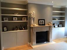 custom made built in floating shelves and cabinets by