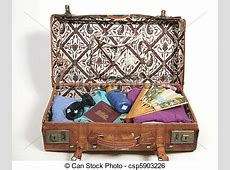 Open suitcase with vacation items. Vintage open suitcase