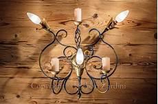 candele ornamentali applique a 3 con volute boccoli in ottone e candele
