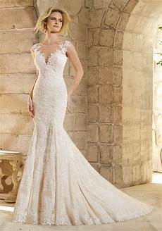 lace dress decorated with appliques wedding dress style