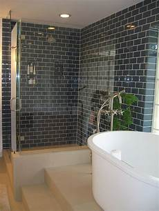 glass subway tile bathroom ideas teal subway tiles and a glass enclosed shower give