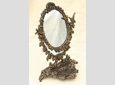 ornate old cast iron tilt mirror on stand, shaving or