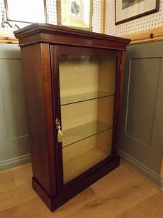 late mahogany display cabinet with glass shelves