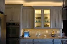 installing lighting on a glass cabinet inspiredled