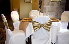 gold chair bands with diamante brooch on white chair