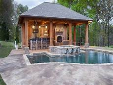 pool and pool house designs with brick wall and fireplace