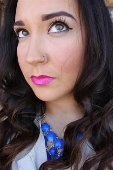 winged eyeliner bright pink 60 s makeup