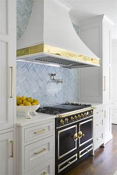 Light Blue Kitchen Tiles Light And Bright Kitchen With White Cabinets And Brass