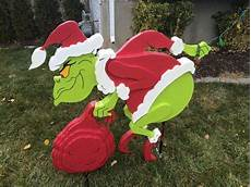 The Grinch Pulling Down Lights The Grinch Is Stealing My Lights Grinch Christmas