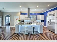 Spacious Contemporary Kitchen With Blue Accent Wall, Unique Hardwood Flooring   HGTV