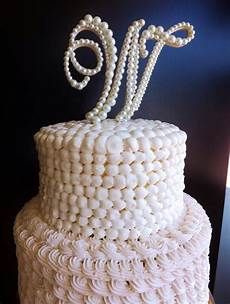 white pearl wedding cake topper monogram paris bakery