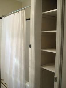 bathroom closet door ideas take the door your bathroom linen closet for a chic