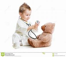 Children Play Doctor Kid Or Child Playing Doctor With Stethoscope Stock Photo