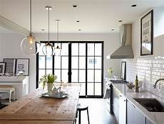 Glass Pendant Lights Over Dining Table In The Clear Kitchen Lighting Over Table Home Kitchens