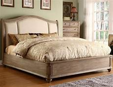 king upholstered sleigh headboard bed with nail trim