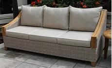 wicker teak wood sofa with sunbrella cushions