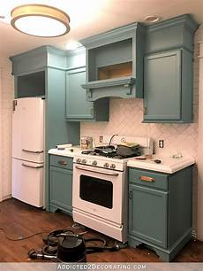 my freshly painted teal kitchen cabinets