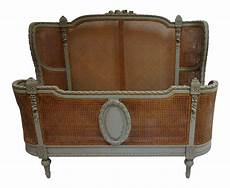 mid 19th century antique caned bed in 2020