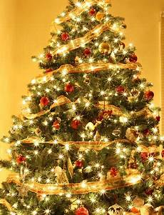 Christmas Tree With White Lights Do You Decorate Your Christmas Tree With White Or Colored