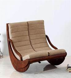 milton two seater rocking chair in honey oak finish by
