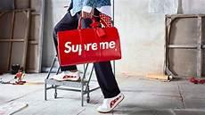 supreme retailer louis vuitton x supreme draws queues inside retail