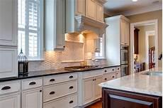 white kitchen cabinets with white backsplash 15 inspiring white kitchens celebrate decorate