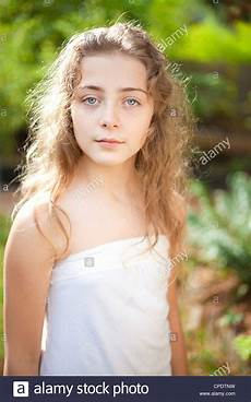 Younger Teens A Young Girl With Long Curly Blond Hair Is Outside