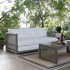 modway aura gray wicker outdoor sofa with white cushions