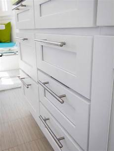contemporary nickel drawer pulls in white kitchen