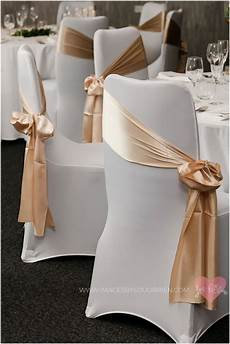 white chair cover with gold sash side tied wedding in