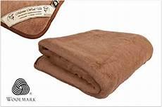 warm luxury camel reversible mattress topper
