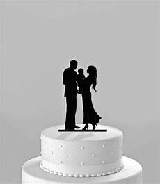 wedding cake topper silhouette bride groom holding baby