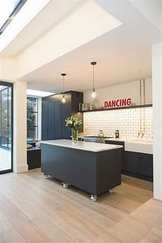 8 Exles Of Kitchens With Movable Islands That Make It Movable Kitchen Island With Seating Bench Flowers Hanging