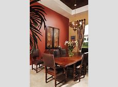 burnt orange dining room mediterranean with red wall chrome mirrors
