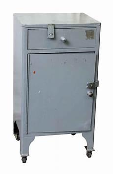 small steel locked cabinet on wheels olde things