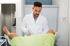 Free Gyn Young Gynecologist Exam His Patient At Clinic Stock Image