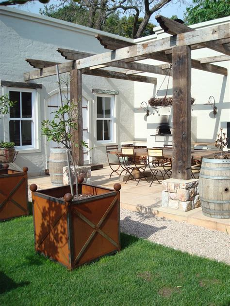 reclaimed wood pergola with outdoor dining patio