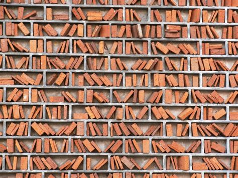 libro brick not books but bricks that look like books this is a wall outside the wimbledon libary via