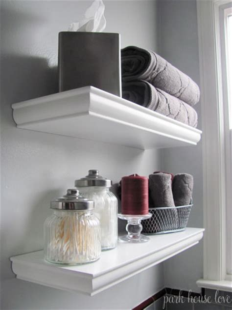 floating shelves over toilet tissue box containers