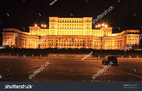 the people s house night image of a car in front of the the palace of the