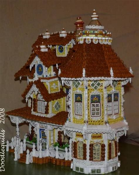 small worms in house that curl up so this dollhouse is done entirely by quilling that is