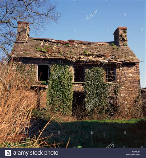 derelict abandoned house cottage with roof