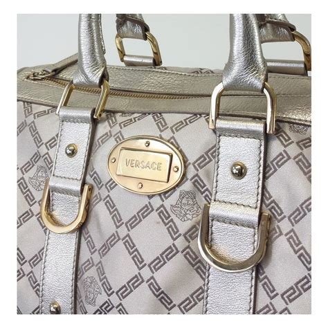 Versace Metallic Jacquard Snap Out Of It Bag by Versace Gold Tone Hardware Metallic Monogram Silk Jacquard